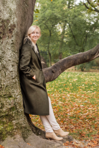 blonde girl wearing a green loden coat in Vienna, Austria